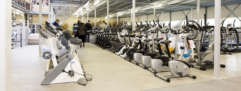 Eigen distributiecentrum waar u alle fitnessapparaten kunt uitproberen!